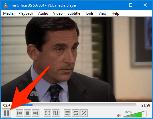 VLC window with the pause button highlighted