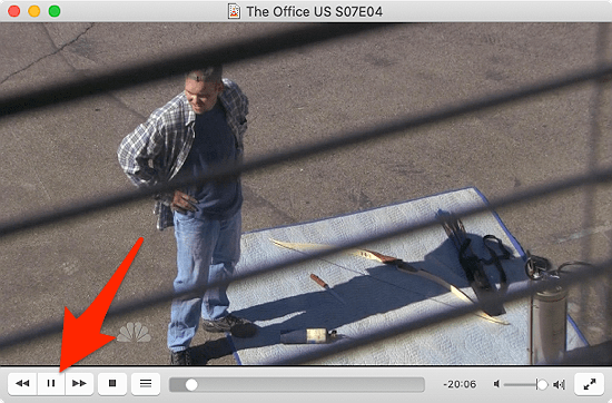 VLC for macOS with the pause button highlighted
