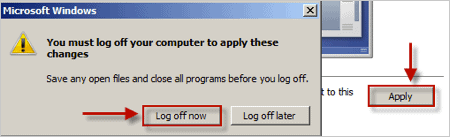 an arrow pointing at an Apply button in the Display panel of Windows 7's Control Panel