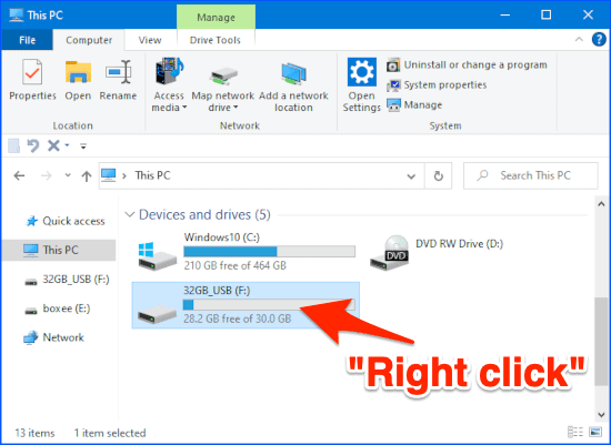 a File Explorer window with an arrow pointing to a USB thumb drive volume