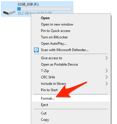 the USB drive context menu in Windows with an arrow pointing to the Format option