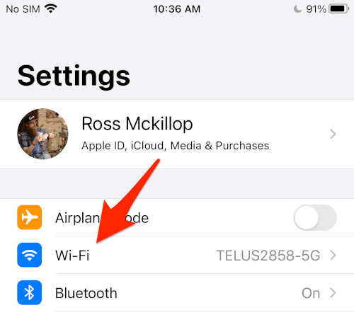 the iOS Settings menu with an arrow pointing to the Wi-Fi entry
