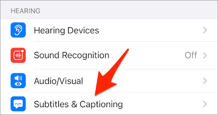 an arrow pointing at Subtitles & Captioning from the HEARING section of the iOS Settings