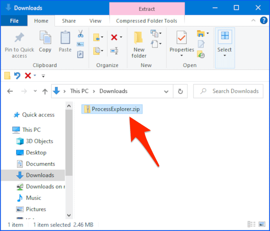an arrow pointing to a zip file in Windows Explorer