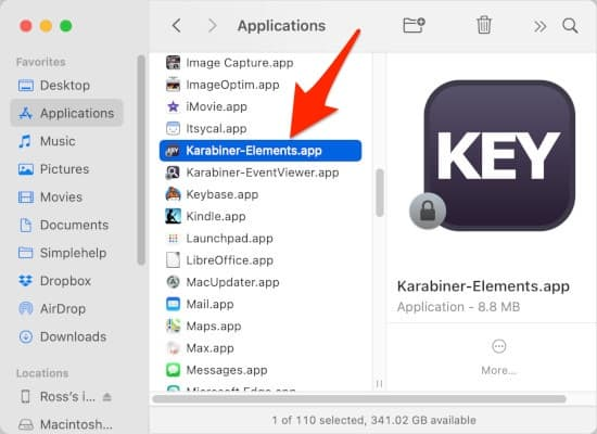 Finder window with an arrow pointing to the Karabiner-Elements.app file