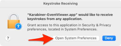 an arrow pointing to an Open System Preferences button
