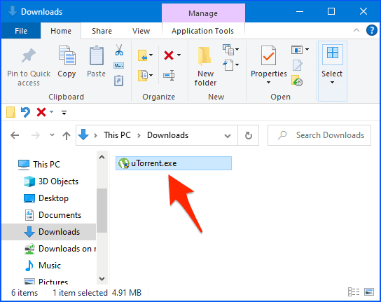 windows file manager with an arrow pointing to the uTorrent installer file