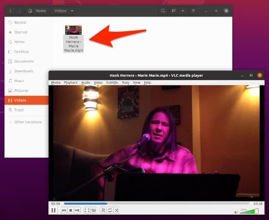 an Ubuntu desktop with VLC playing a video file