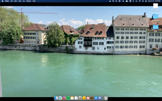 a macOS desktop with a web page as a video as the background